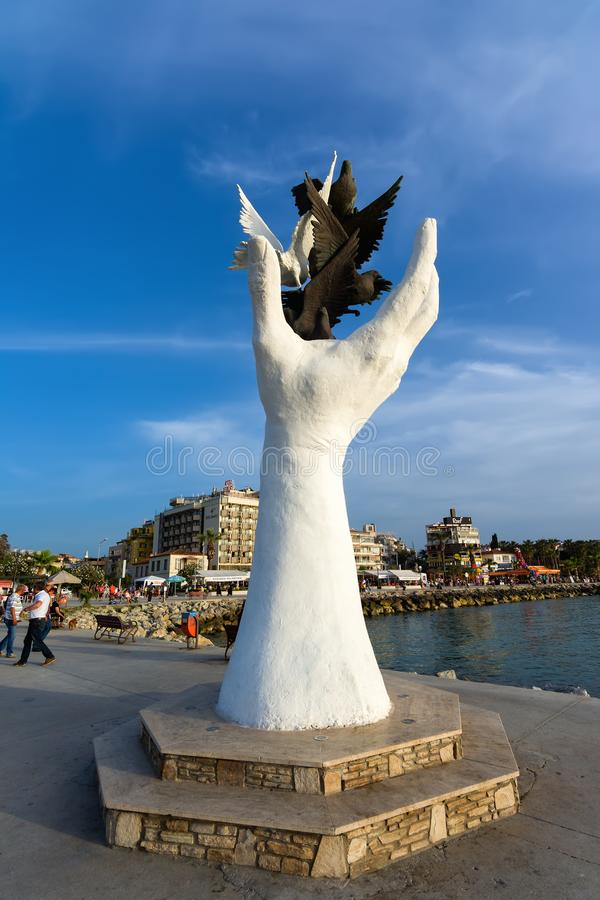 KUSADASI, TURKEY - MAY 23, 2015: The hand of peace sculpture with doves on the waterfront in Kusadasi, Turkey stock images