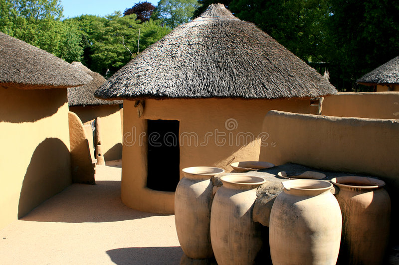 Kusasi houses of Ghana. Houses like these can be found in Tempane, in the north-east of Ghana. Traditional elements are the roundings and the failure of a door royalty free stock photography