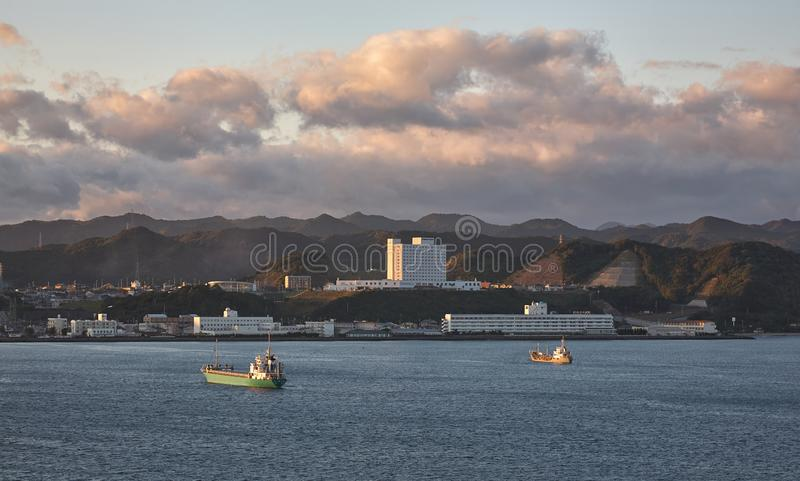 Kushimoto town at the sunset light. Wakayama Prefecture. Honshu. Japan. The sea view of Kushimoto town coastline surrounded by the mountains at the sunset light stock photos