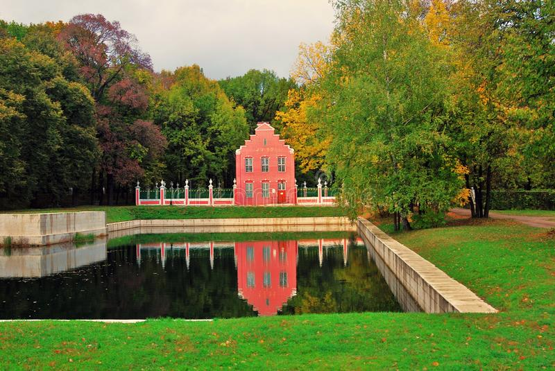 Kuskovo park in Moscow. Dutch house. Autumn nature and pond. MOSCOW RUSSIA - OCTOBER 08, 2015: Kuskovo park in Moscow. Dutch house. Autumn nature and pond stock image