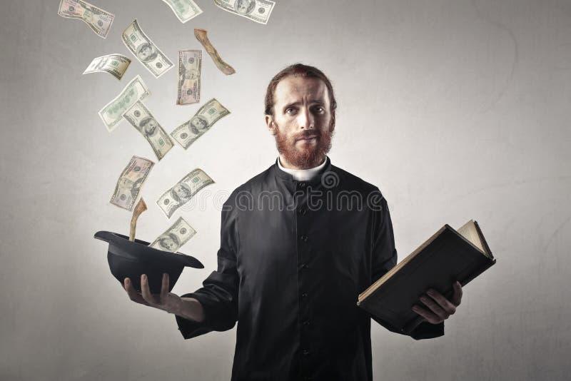 Kuslig präst arkivfoto