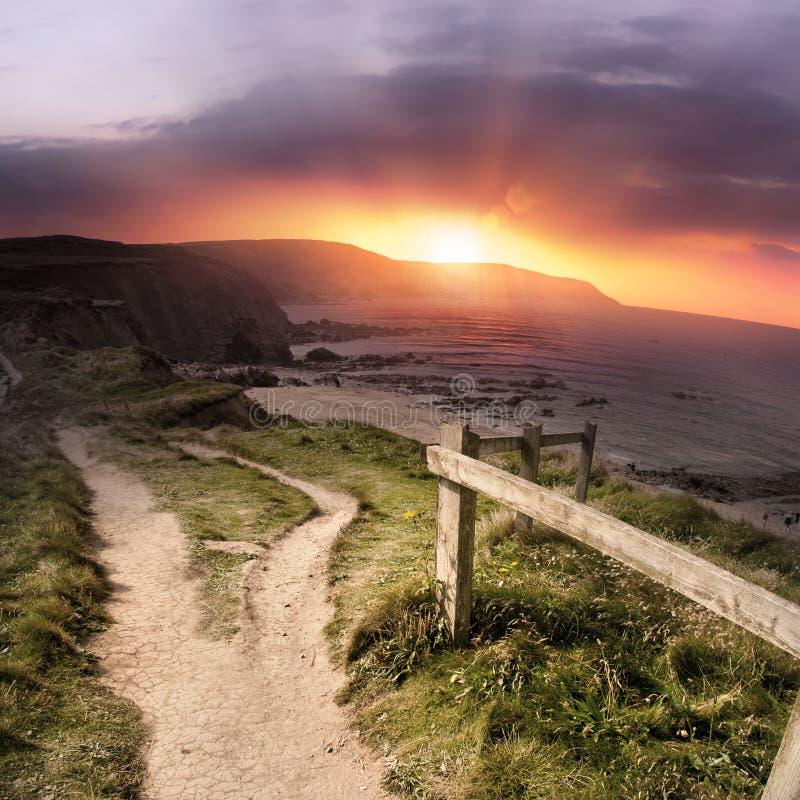 kust- scenisk solnedgång royaltyfria foton