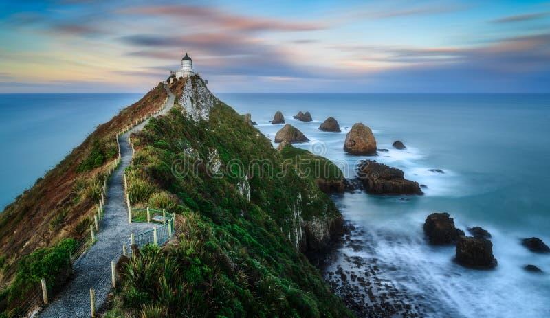 kust- sikt för klumppunktsolnedgång royaltyfri bild