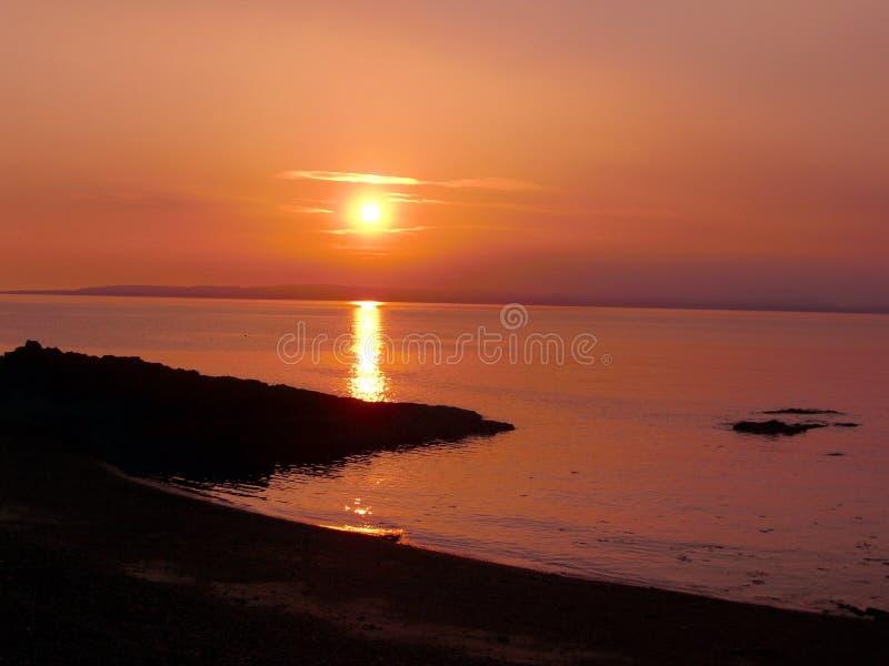kust- solnedgång arkivbild