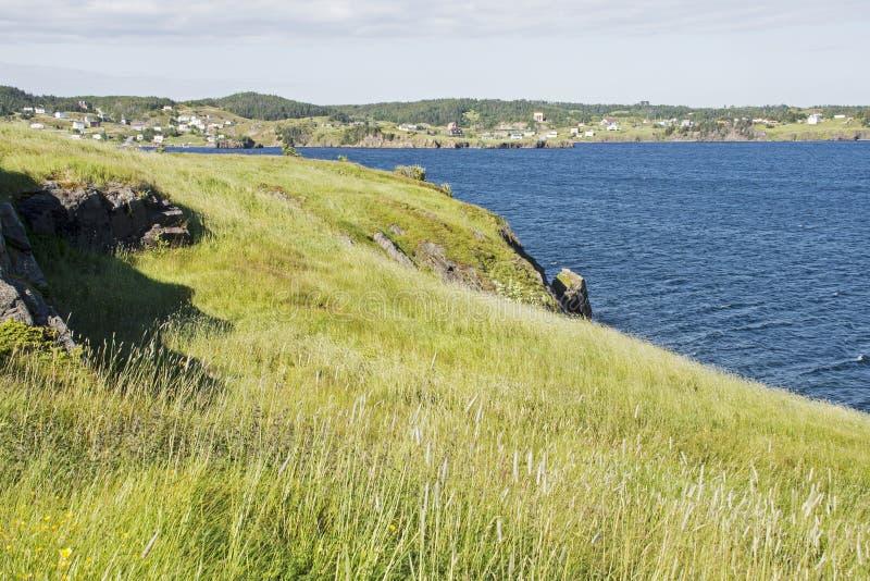 Kust- udde med bosättningen royaltyfria foton