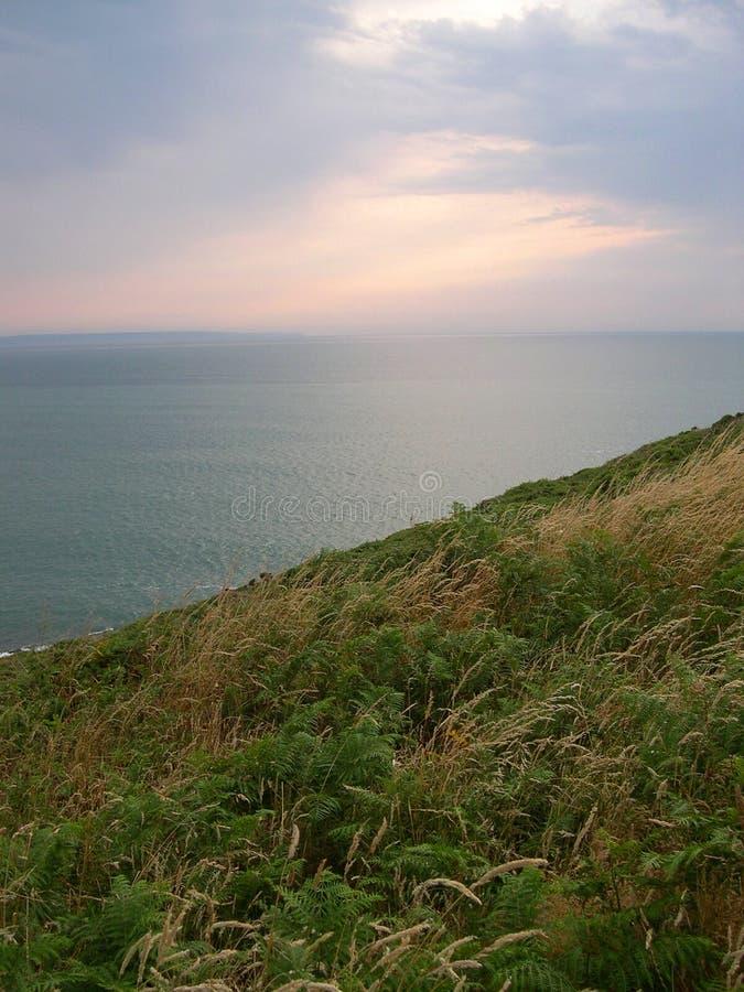 Download Kust- vandringsled arkivfoto. Bild av england, klippor, solnedgång - 75040