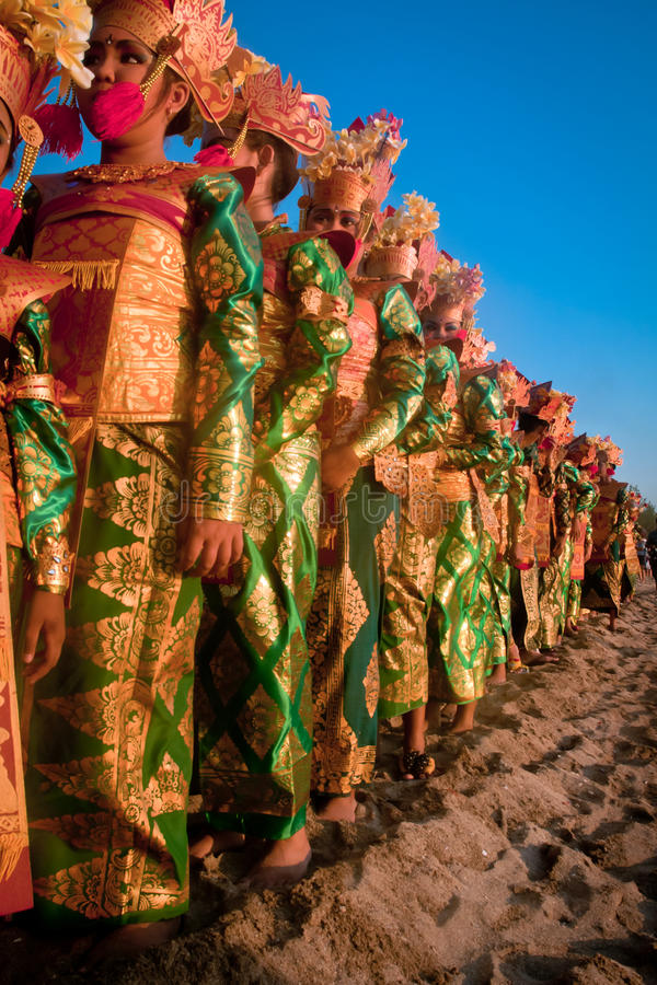 Hundreds Legong dancers. Pictures about Hundreds Legong dancers being lined up on Kuta Beach, Bali - Indonesia. Celebrated with a unique costume parade royalty free stock photo