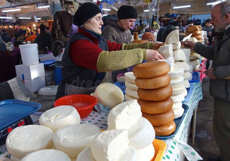 KUTAISI, GEORGIA - January 3, 2017: Women selling homemade and smoked cheese on big food market. Traditional Caucasian homemade cheese sulguni. Market, Georgia stock photos