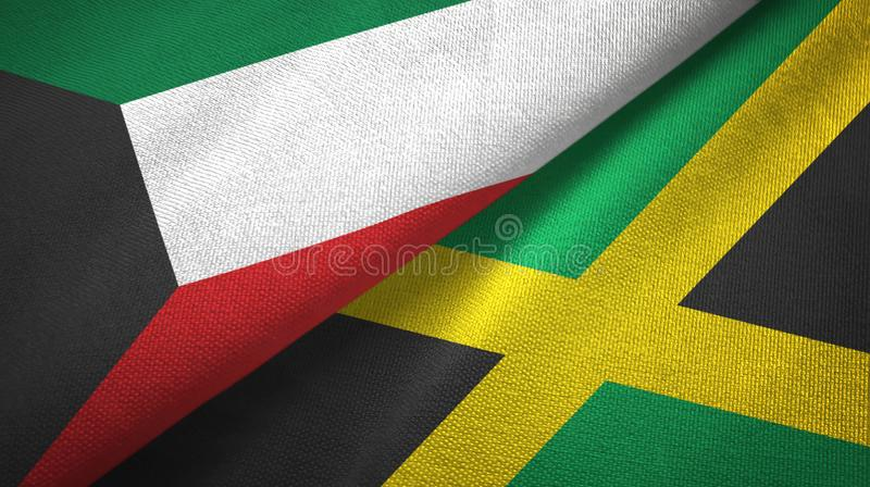 Kuwait and Jamaica two flags textile cloth, fabric texture royalty free illustration