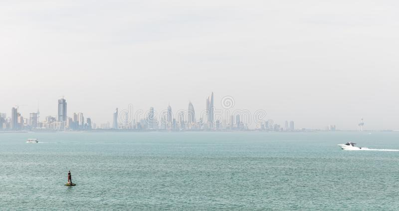 Kuwait`s coastline and skyline. KUWAIT CITY, KUWAIT - 19 Mar 2018: Kuwait`s coastline and skyline royalty free stock images