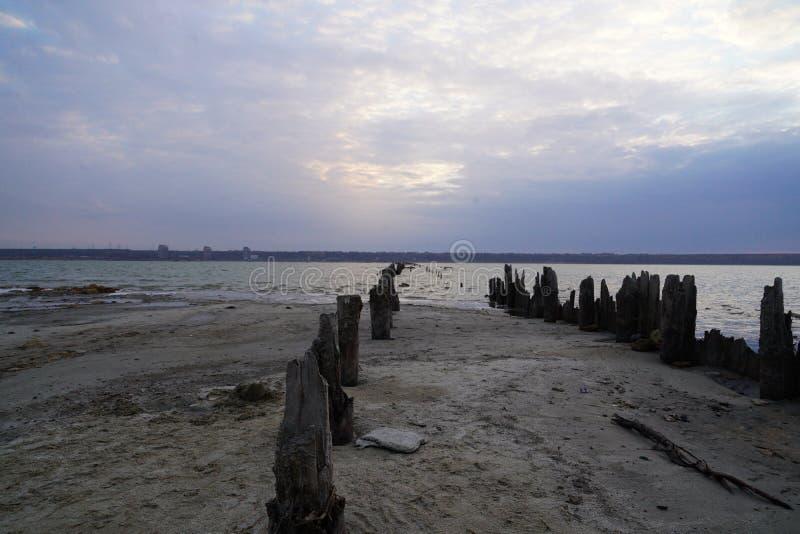 Kuyalnik estuary landscape. Kuyalnik liman salt lake in Odessa region of Ukraine. Wooden piles in a salt lake Kuyalnik stock photography