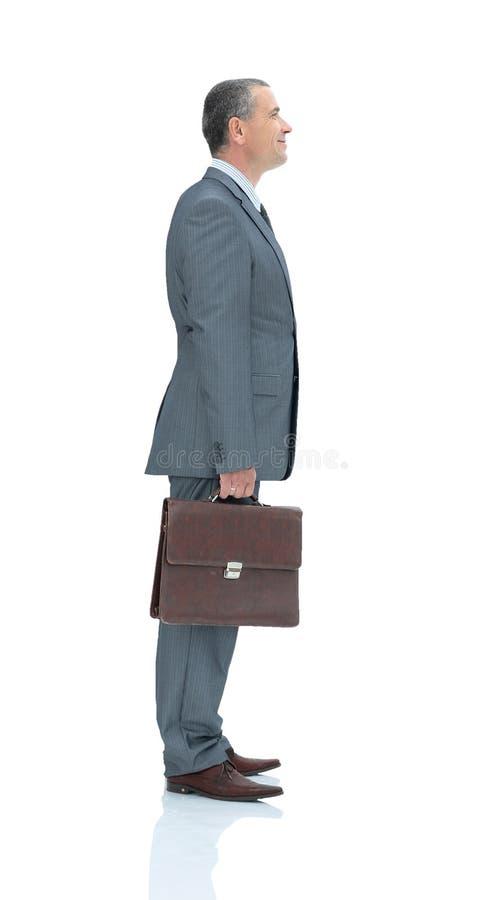 Kvalificerad advokat i en affärsdräkt med portföljen som isoleras på royaltyfria bilder