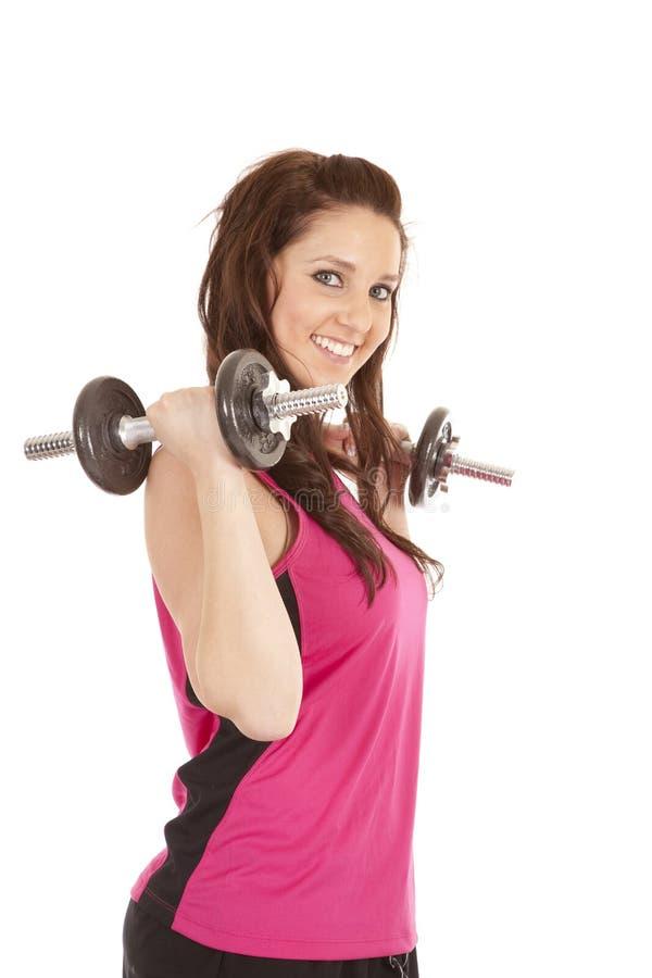 kvinna för ärmlös tröja för krullningshantlar rosa arkivfoto