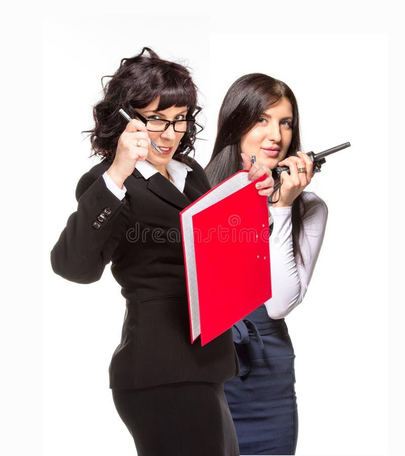 Kvinna för affär två med mapp- och cbradion arkivfoto