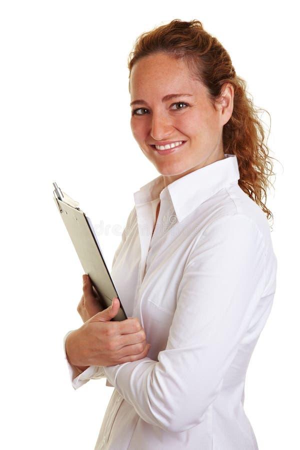 kvinna för affärsclipboardholding arkivbild