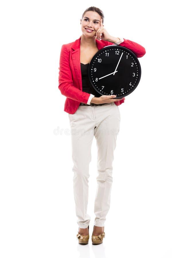 kvinna för affärsklockaholding royaltyfri foto