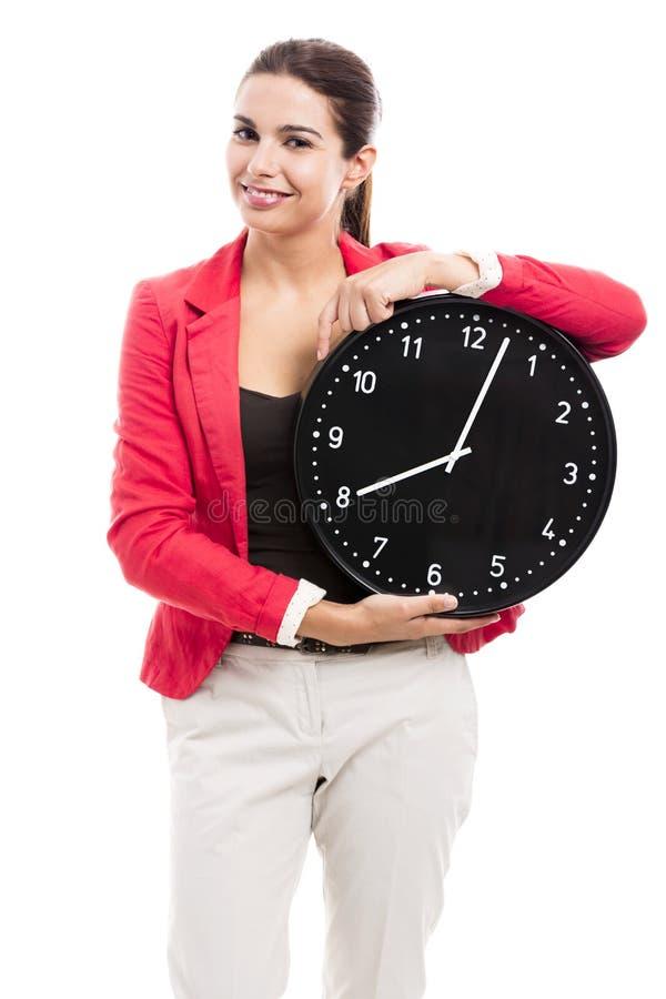 kvinna för affärsklockaholding arkivbild