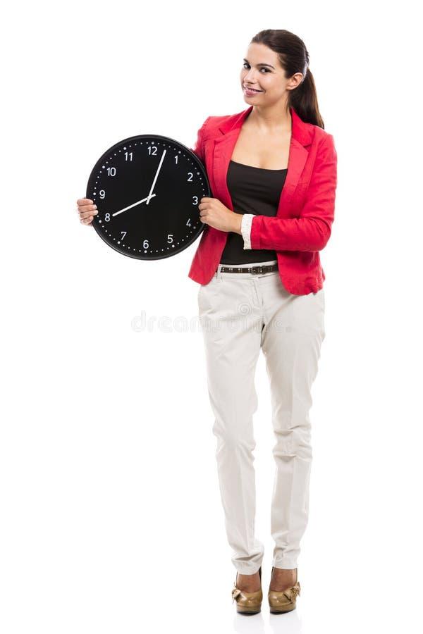 kvinna för affärsklockaholding royaltyfri bild