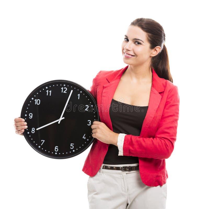 kvinna för affärsklockaholding fotografering för bildbyråer