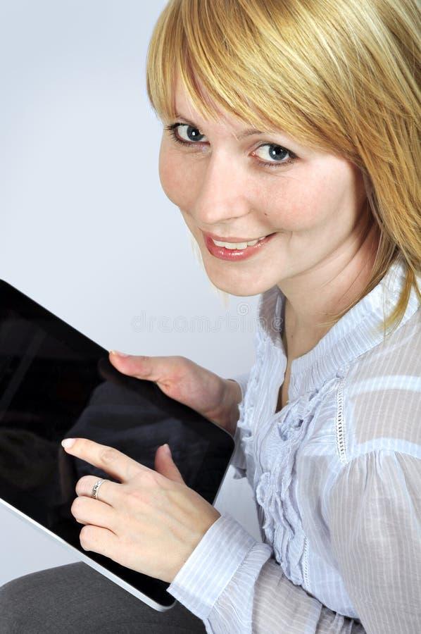 Kvinna För Apparatblocktouch Royaltyfria Bilder