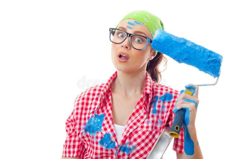 Kvinna för husmålare arkivfoton