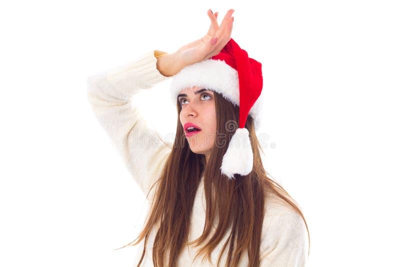 kvinna för julhattred arkivfoton