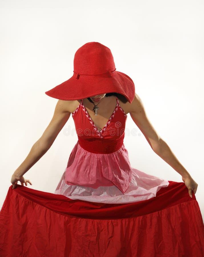 kvinna för klänninghattred royaltyfri fotografi