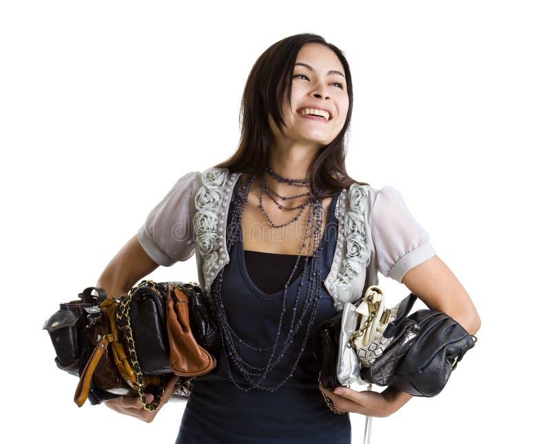 kvinna för många handväskor fotografering för bildbyråer