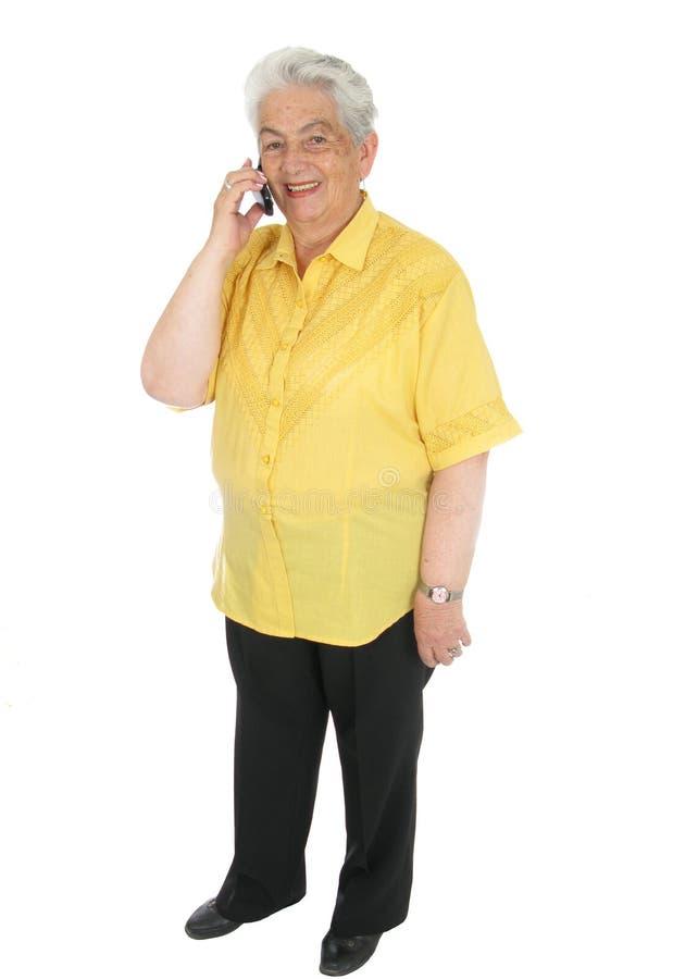kvinna för pensionär för celltelefon arkivbild