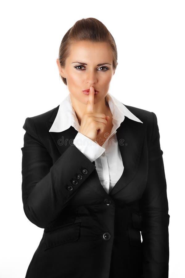 kvinna för shh för mun för affärsfingerge modern arkivbilder