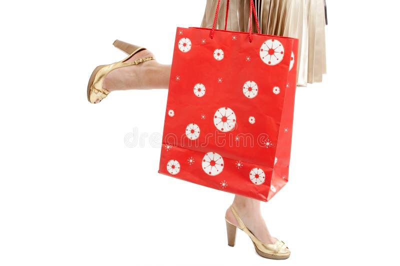 kvinna för shopping för benpaketkörning arkivfoton