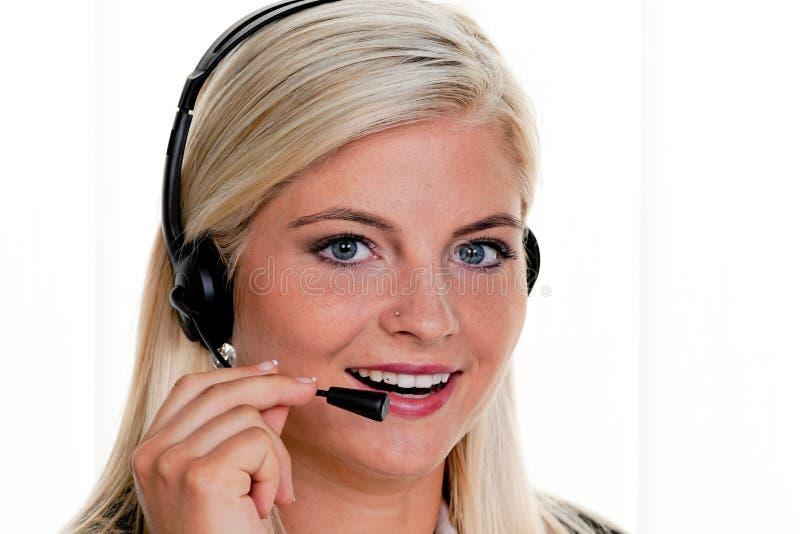 kvinna för telefon för hörlurar med mikrofon för felanmälansmitt royaltyfri foto