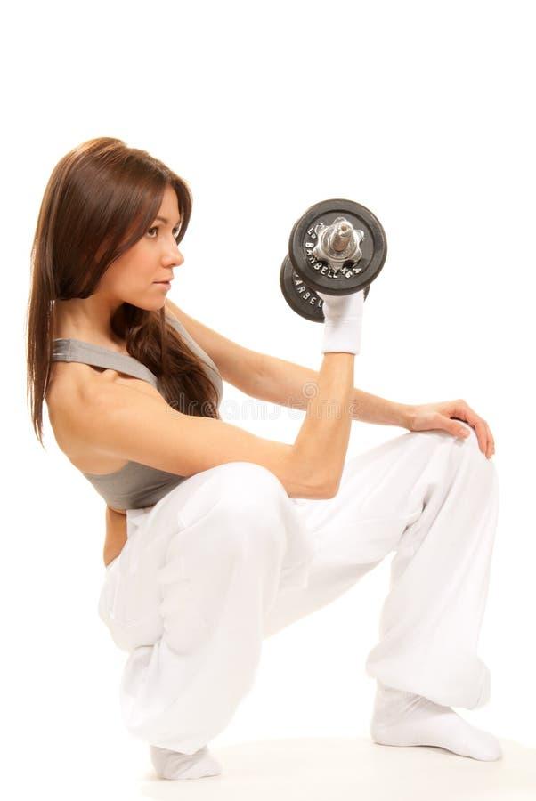 kvinna för weightlifting för hantelkonditioninstruktör royaltyfri foto