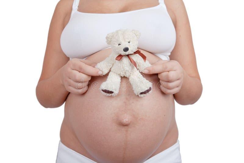 kvinna för white för toy för björnhandhåll gravid arkivbild