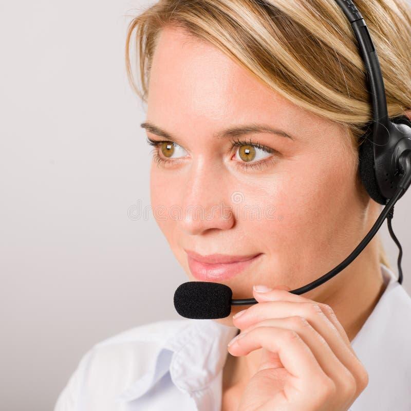 kvinna för telefontjänst för operatör för felanmälanskundhörlurar med mikrofon royaltyfri fotografi
