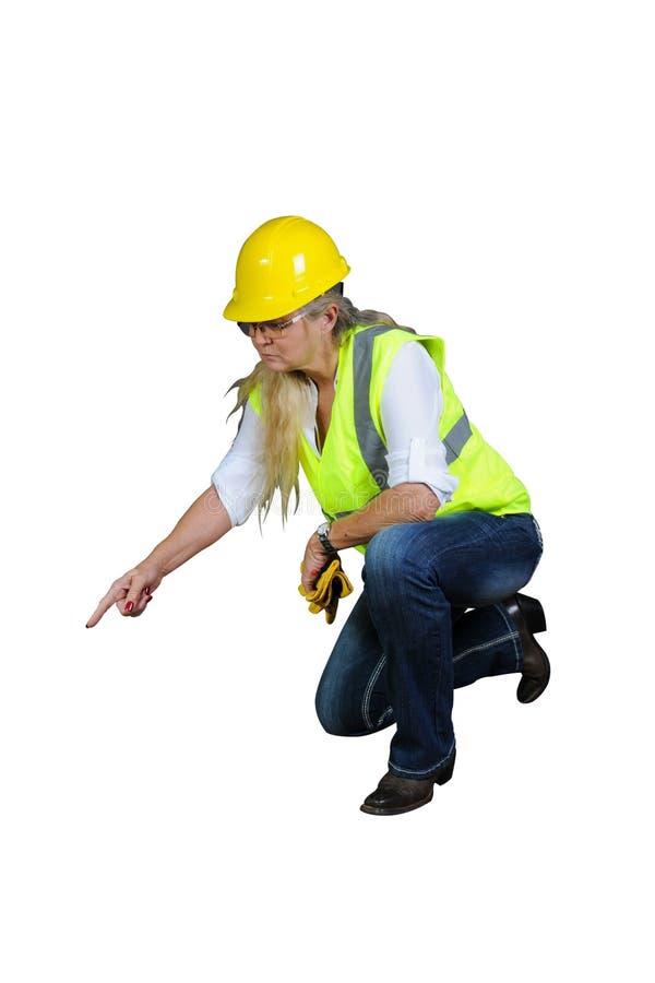 Kvinna i arbete för säkerhetsväst och för hård hatt royaltyfria foton