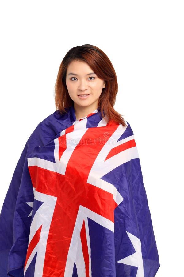 Kvinna i australisk flagga royaltyfria foton