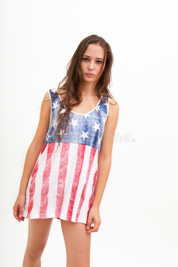 Kvinna i bästa färger av USA flaggan och jeans fotografering för bildbyråer