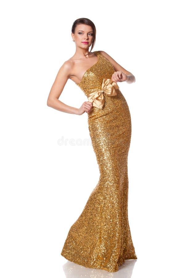 Kvinna i guld- klänning arkivfoton