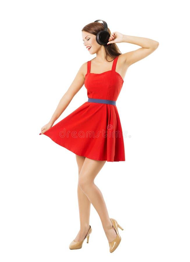 Kvinna i headpnones som dansar att lyssna till musik som isoleras över vit arkivfoton
