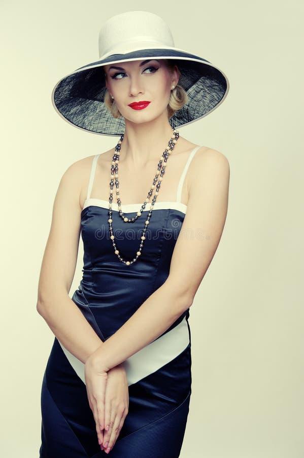 Kvinna i klänningen som isoleras på white royaltyfria bilder