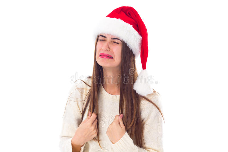 Kvinna i röd julhattgråt royaltyfri foto