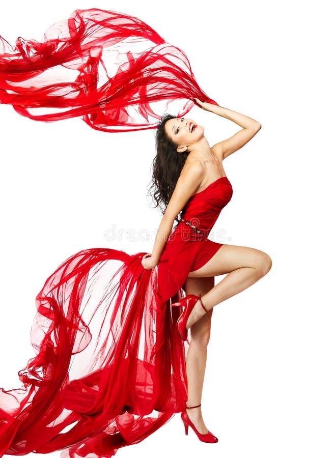 Kvinna i röd klänningdans arkivfoton