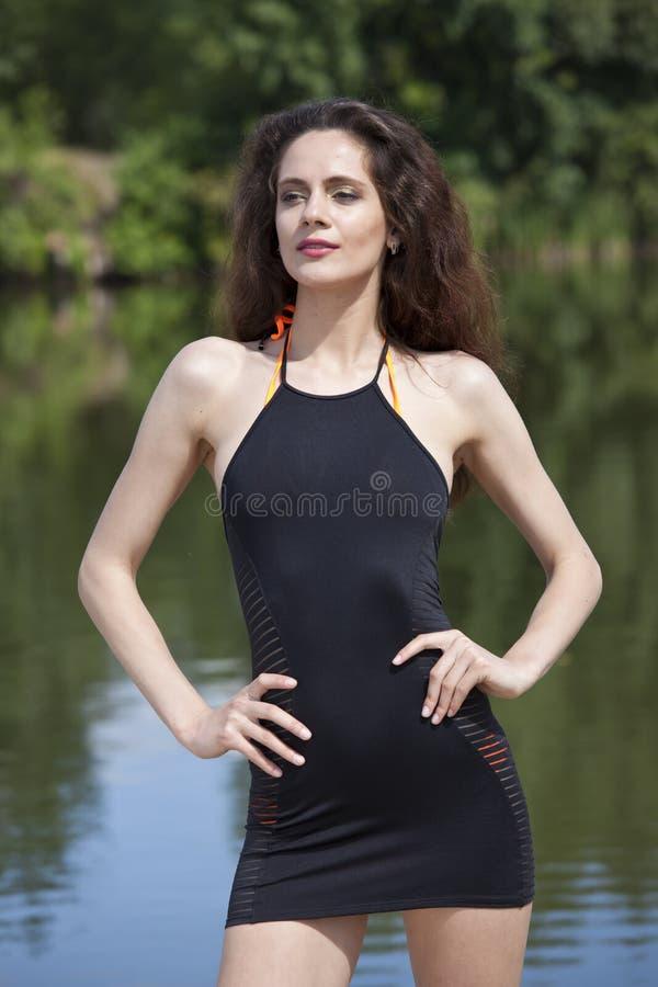 Kvinna i sommarklänning royaltyfria foton