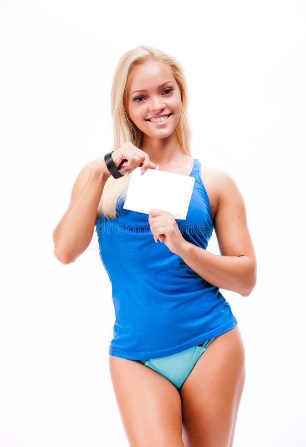 Kvinna i sportstilanseende mot vit bakgrund royaltyfri bild