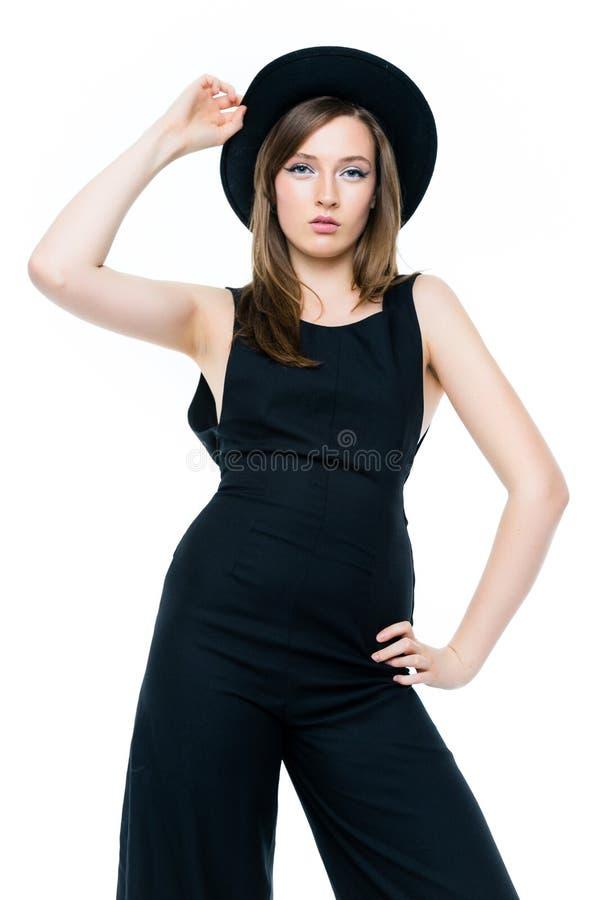 Kvinna i svart overall och hatt royaltyfri fotografi