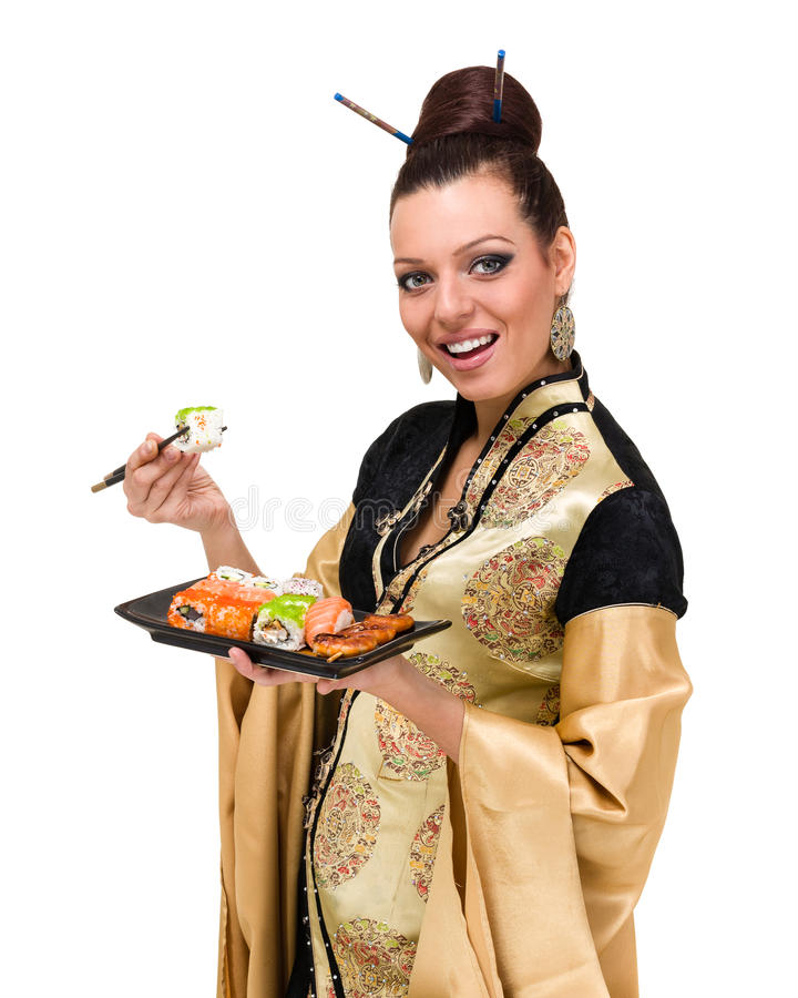 Kvinna i traditionell klänning med östlig mat arkivfoton