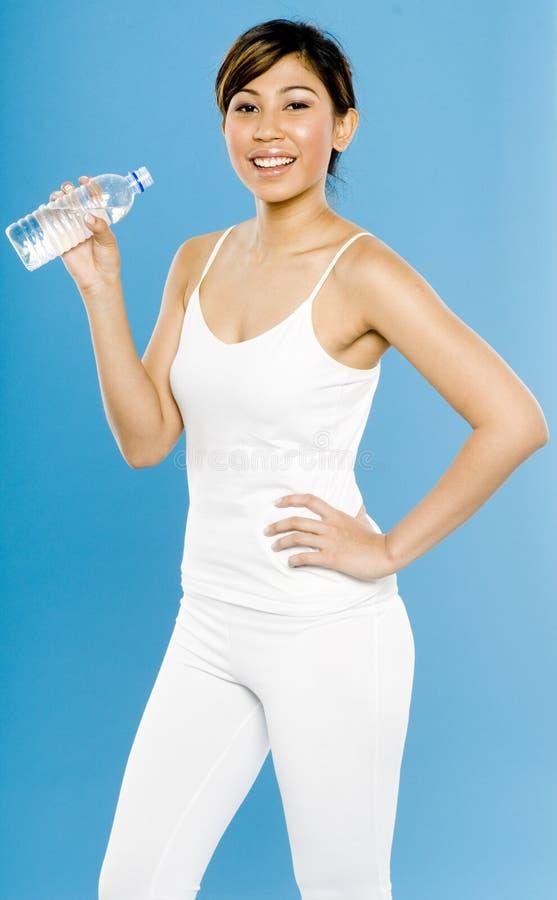 Kvinna i White på Blue royaltyfri foto