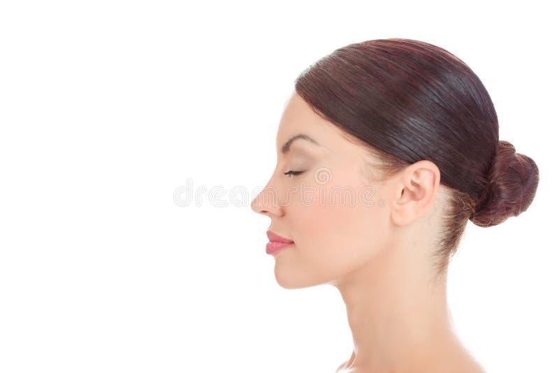 Kvinna med ögon som stängs i sidosikt arkivfoton