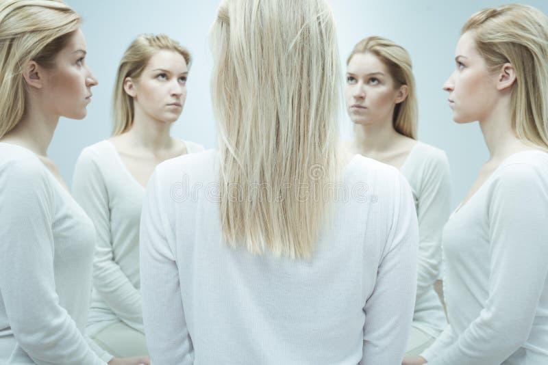 Kvinna med alter ego arkivbild